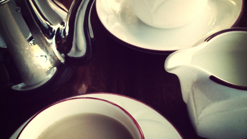 Tea pot, cups and milk.